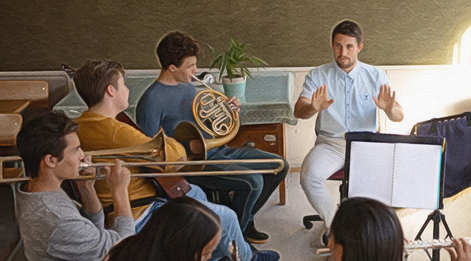Middle-schoolers playing musical instruments in a band
